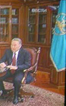 [President Nazarbaev and his flag]